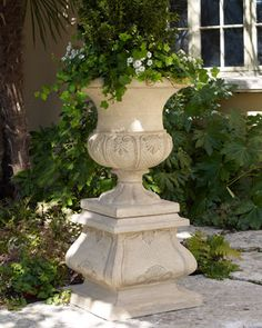 "Serious;y obsessed with this urn/pedestal combo... ""French Leaf"" Urn Planter & Pedestal at Horchow."