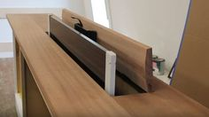 Hide your television when not in use by building this TV lift cabinet.