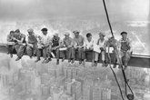 1932 - steel workers on teh 70-story RCA building in Rockefeller Center having lunch on a steel beam with a sheer drop of more than 800 feet to the street level.