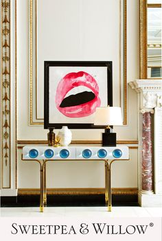 Welcome a sense of futuristic glamour to your hallway or living room with the Globo Console by Jonathan Adler. The white, high-gloss lacquer piece is brought to life by the polished brass base and large, blue acrylic cabochons. #sweetpeaandwillow #jonathanadler #artdeco #americanglamourinterior #hollywooddecor Jonathan Adler, Sweetpea And Willow, Art Furniture, Lacquer Furniture, Furniture Storage, Contemporary Furniture, Modern Console Tables, Modern Art Deco, Interior Design Inspiration