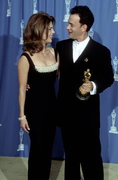 Pin for Later: All the Fun Vintage Pictures From the Oscars Press Room  Rita Wilson and Tom Hanks, 1995