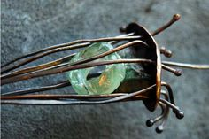 Cages are fun to build and they allow you to use found objects or small items that you want to wear but can't quite find a connection. This cage is filled with three pieces of Roman Era glass that I. I Love Jewelry, Copper Jewelry, Wire Jewelry, Bridal Jewelry, Jewelry Crafts, Beaded Jewelry, Jewelry Design, Jewlery, Wire Earrings