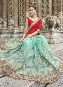 Smashing Aqua Blue Designer Fashion Saree Work:-Thread and Zari Embroidery with Patched Border and Patch Butta Fabric:-Georgette Paired with the matching blouse piece. Lehnga Dress, Lehenga Choli, Sari, Indian Party Wear, Embroidery Saree, Beautiful Girl Photo, Traditional Sarees, Half Saree, Party Wear Sarees