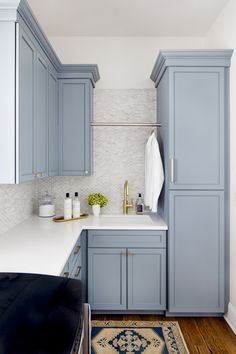 New Traditional in Baltimore | A Busy Baltimore Family Undergoes a Major Home Renovation That Fits All of Their Needs | Interior design by Stephanie Gamble Interiors | Photo by Jennifer Hughes | Laundry Room Inspiration | Laundry Room Ideas | Light Blue Cabinetry | Blue Cabinetry with Gold Pulls | Stylish Laundry Room | Modern Sanctuary | Traditional Home | Blue Cabinetry with White Counters | Laundry Room Design | Kitchen Design