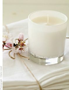 White linen napkins and scented candle.