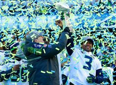 Seattle Seahawks owner Paul Allen, left, lifts the Vince Lombardi Trophy with Seahawks quarterback Russell Wilson