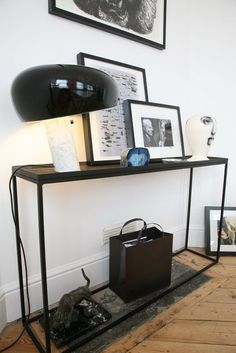 The Snoopy lamp adds spunk and playfulness to this modern interior with hardwood floors and unique framed photographs.