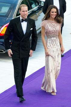 In their most glamorous appearance after the wedding, and their first married red carpet, William and Kate attended the Ark Gala in London; Kate wears Jenny Packham.