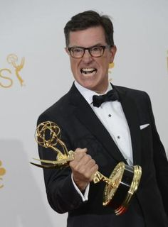 2014: The Year in Entertainment - Photos - UPI.comStephen Colbert holds his Emmy for Outstanding Variety Series for 'The Colbert Report', at the Primetime Emmy Awards at the Nokia Theatre in Los Angeles on August 25, 2014. UPI/Phil McCarten  Read more: http://www.upi.com/News_Photos/2014/2014-The-Year-in-Entertainment/fp/8740/#ixzz3LKpNJAVp