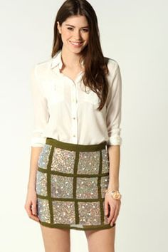 Eliza Georgette Sequin Short Skirt. Worn with white collar shirt. Acessorize with golden jewellry (large golden hoops, chunky chain bracelet or thick watchband)