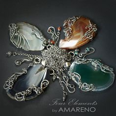 Wire work pendants by Amareno