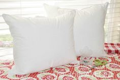 Cut a king sized pillow in 1/2 to get 2 throw pillows. I've also seen where they cut down a standard pillow to get 1 throw pillow and then use a pillow protector as the cover (paint it with fabric paint). An inexpensive way to get throw pillows.