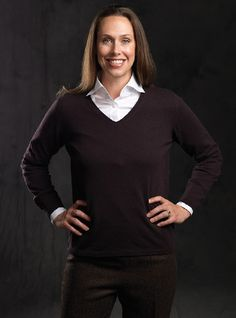 Our Scottish knitted classic V-neck long sleeve sweater in mocha color cashmere is available in sizes XS-XL. This slim and lightweight cashmere classic is shown with our wardrobe essential, a tailored long sleeve pure white cotton stretch blouse, with a soft wide spread collar and three buttons on the cuff. Available in sizes 4-12. Combine our coffee herringbone pants, this white shirt and V-neck sweater, for a compelling classic outfit.
