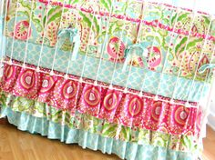 The bumper pad and the fitted crib sheet are my patterns for Kinley's room! I incorporated a hot pink polka dot insteas of the other pattern! It's called Kumari Garden!