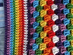 Giant rainbow granny square using hdc instead of dc stitches. Rows of sc for borders. Love it.