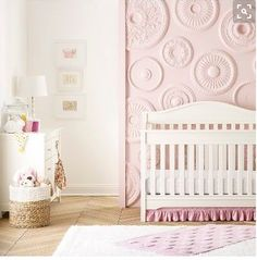 Outfit your baby's new bedroom in mix-and-match nursery d_cor with the Sweet Ruffles Nursery Bedding Collection. Choose between classic white or walnut cribs, dressers and gliders, then add in pink baby bedding like a ruffled comforter and a knitted crib sheet. Finish the look with a polka dot rug and bunny rabbit security blanket. No matter which pieces you choose, you'll create a coordinated room you and your little one will love.