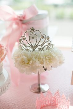 Decorate a table with crown on stand, hat box with ribbon...adds interest