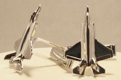 This is a pair of solid cast sterling silver cuff links of the F-35A Lightning II, which is theU.S. Air Force version of this plane. As with all of my airplane jewelry, the master model was hand carved by myself, and each piece is cast, assembled and finished by me as well. This guarantees the highest quality product possible, as I hand polish them instead of using mass finishing machines, which can eliminate detail.     Each piece comes with a 30 day money back guarantee. If you simply…