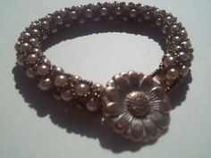 http://www.etsy.com/listing/93538677/netted-pearls-beaded-bracelet-jewelry