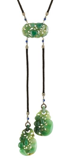 Art Deco Carved Jade, Diamond, Platinum, Diamond and Cabochon Sapphire and Cord Necklace. One oval carved jade ap. 16.5 x 28.0 x 5.2 mm., 2 drop-shaped carved jade ap. 34.5 x 20.5 x 6.4 mm. & 33.5 x 20.8 x 6.4 mm., c. 1920. Length 32 7/8 inches.