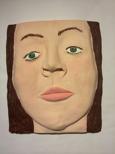 Relief sculpture earth clay from plaster cast of plastilina model. Self portrait