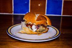 Seasoned burger with sauteed salami on challah bread.