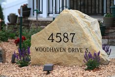 Looking for a unique address marker that accents the beauty of any home? Here's one of our limestone boulders used as a address marker on a recent ‪landscape‬ project.
