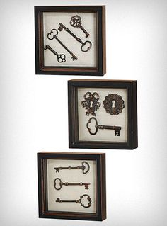 These antique shadowboxes are the perfect vintage inspired touch for any decor! A fine art look for a fraction of the price, they feature a variety of antiqued copper cast metal 3-D keys and locks mounted on a natural burlap background and surrounded by a distressed black wood frame.