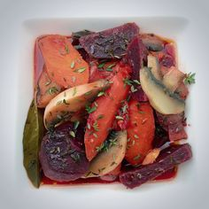 Vegetables in red wine with fresh thyme and bay leaf