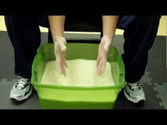 Learn about Rice Bucket Hand Exercises - Martial Arts Strengthening Drill - Black Belt Wiki