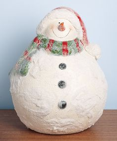 Complete the seasonal décor with the help of this sweet snowman figurine. Its carefully crafted design makes it the perfect candidate for any bookshelf or mantelpiece in need of a little holiday cheer.