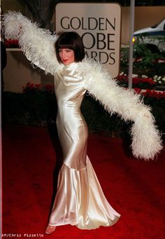 "Lara Flynn Boyle of the television drama ""The Practice,"" shows off her outfit at the arrivals of the 56th Annual Golden Globe Awards, Sunday, Jan. 24, 1999"
