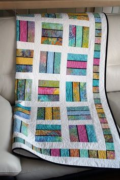 """This lap quilt is made of high quality cotton in order to offer you a one of a kind product that will embellish your comfort for years to come. The # scrappy patchwork quilts For CUSTOM ORDER ONLY, Throw quilt """" Ici et Là """" Patchwork Quilting, Batik Quilts, Jellyroll Quilts, Big Block Quilts, Lap Quilts, Strip Quilts, Quilt Blocks, Panel Quilts, Jelly Roll Quilt Patterns"""
