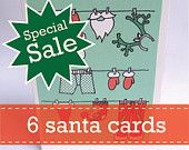 Xmas Sale: Pack of 6 exclusive unique and funny Christmas cards with Santa Claus' Clothesline including envelope. £9.5