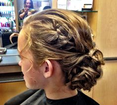 Low curled braided bun for a wedding, updo