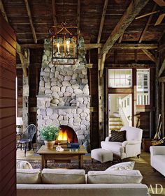 Cabin Living Room: I'm loving the stone fireplace. This chalet look is accented by simple chic furniture. Cabin Homes, Log Homes, Cabins And Cottages, Architectural Digest, My Dream Home, Decoration, Living Room Designs, Living Rooms, Living Spaces