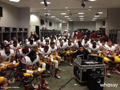 The Trojans gather around for the pregame speech...