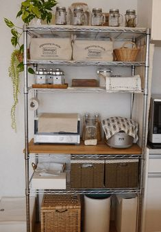 Add solid board to create usable surface on pantry shelf - bar? Also, tidy shelf organization: combo of glass jars, baskets, trays, etc. Kitchen Rack, Small Kitchen, Kitchen Remodel, Kitchen Decor, Shelf Makeover, Kitchen Dining, Home Kitchens, Kitchen Dinning, Diy Kitchen