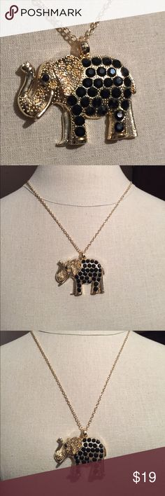 Long elephant necklace Long elephant necklace set in gold tone metal with black created stones. Upturned trunk for good luck. New never used. See photos for details. Jewelry Necklaces