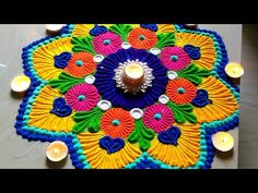 Here is a simple freehand diwali special flower rangoli design for Diwali. It is based on one of my original rangoli designs and I have tried to do some inno...
