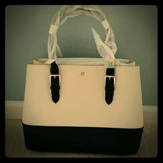 NWT Kate Spade Cove Street Colorblock Ariel NWT Kate Spade colorblock Ariel tote in cream with black. Textured leather, gold hardware, protective feet. Gorgeous cream and black diamond lining. 2 large main compartments with zippered interior compartment in the center. 2 smaller pockets and 1 zippered pocket. 15 l x 11.9 h x 6.2 w. Price is firm. No offers, no bundles! kate spade Bags Totes