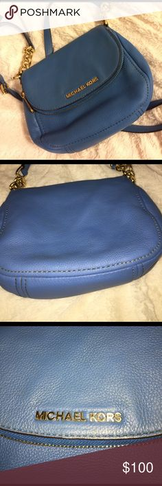 Michael Kors baby blue cross body bag. Worn a couple times. No rips, tares, scratches stains etc. on both inside and out. A little ware on the bottom but barely noticeable. Excellent condition and super cute for spring time! Michael Kors Bags Crossbody Bags