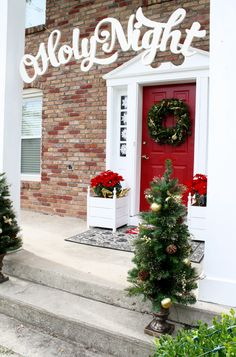 "We love the ""O Holy Night"" sign on this front porch decorated for Christmas. It's an inspired holiday decorating idea by Jen Woodhouse of House of Wood. 