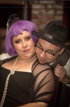 1920s themed party speak easy couples portrait gangster and flapper costume purple