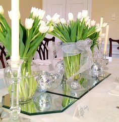 Celebrate the holidays without the traditional red and green. White tulips are a timeless addition to any centerpiece.
