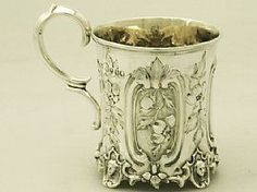 A fine antique Victorian English sterling silver christening mug; part of our…