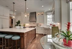 K4. THIS!  White Kitchen Cabinets with glass uppers, Dark Stained Island, apron front sink, pot filler, corner windows.  Just need rustic beams on ceiling and probably darker countertops.  Love the craftsman style corners on the island.