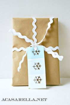 Gift tag with paint chip and snow flake puncher.  So cute!  I already have the puncher...can't wait to make a few of these;)