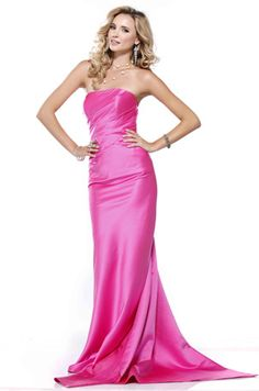 BG Haute by Scala - E19114  Classic and chic floor-length gown featuring a tube top neckline, side seam gathering, as well as center back bow detail paired with a gracefully draped train.