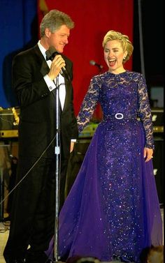 Inaugural ball gowns through the years -- President Clinton and his wife,  Hillary Rodham Clinton, share a laugh at the Youth Ball at the Post Office Pavilion on Jan. 20, 1993, Clinton's first inauguration.